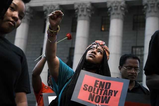 People participate in a protest in front of a New York City courthouse to demand that Mayor Bill de Blasio put an end to solitary confinement in New York's prisons on June 07, 2021 in New York City. Relatives of Kalief Browder and Layleen Polanco, who both died in solitary confinement in New York City, held a prayer, march, and rally in front of City Hall. Over 130 civil rights, religious, social justice groups, and public health groups have signed a letter to the White House calling on President Joe Biden to end solitary confinement. (Photo by Spencer Platt/Getty Images)