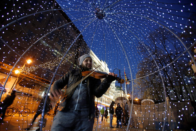 People are seen near a Christmas decoration installed on city Square for the upcoming New Year and Christmas season in Skopje, Macedonia December 23, 2016. (Photo by Ognen Teofilvovski/Reuters)