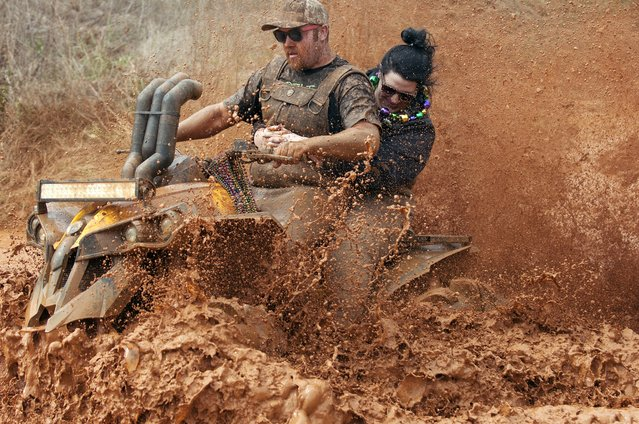 Sam Velis, left, and Whitney Whited ride through a mud pit at the High Lifter ATV Mud Nationals, Thursday, March 26, 2015, at Mud Creek Off-Road Park in Jacksonville, Texas. The annual gathering draws thousands of people of all ages from across the country to camp, ride all-terrain vehicles and participate in and watch various ATV competitions. (Photo by Sarah A. Miller/AP Photo/Tyler Morning Telegraph)