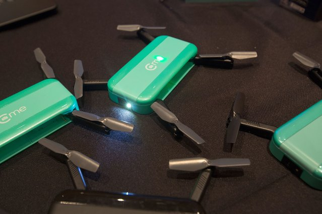 Hobbico hand-sized camera drones are shown at ShowStoppers during the 2017 Consumer Electronic Show (CES) in Las Vegas, Nevada on January 5, 2017. (Photo by David McNew/AFP Photo)