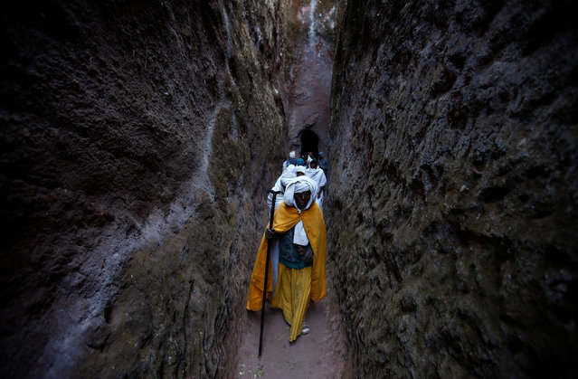 An Ethiopian Orthodox monk walks within a rock hewn church ahead of Ethiopian Christmas in Lalibela, January 6, 2017, on the eve of Orthodox Christmas Day, which is celebrated on January 7. (Photo by Tiksa Negeri/Reuters)