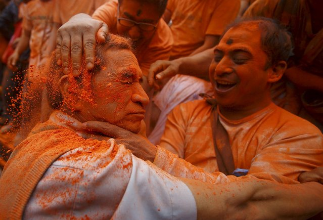 A devotee is smeared with a vermillion powder while celebrating Sindoor Jatra vermillion powder festival at Thimi, in Bhaktapur April 15, 2015. (Photo by Navesh Chitrakar/Reuters)
