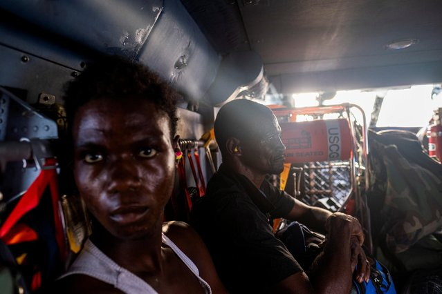 Patients injured during the 7.2 magnitude quake are transported on a U.S. Coast Guard helicopter to Port-au-Price from Les Cayes, Haiti August 21, 2021. (Photo by Ricardo Arduengo/Reuters)