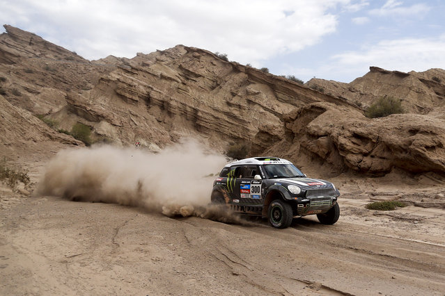 French Mini driver Stephane Perterhansel and co-driver Jean Paul Cottret compete during the Stage 4 of the Dakar 2014 between San Juan and Chilecito, Argentina, on January 08, 2014. (Photo by Victor R. Caivano/AFP Photo)