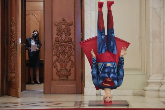 A mannequin depicting Superman is placed upside down next to the door of the parliament session hall hosting a no confidence vote agains Romanian Prime Minister Florin Citu's government in Bucharest, Romania, Tuesday, October 5, 2021. Romania's government fell after 281 lawmakers of the 234 required voted in favor of the no-confidence vote. (Photo by Vadim Ghirda/AP Photo)
