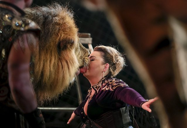"""A lion and its trainer perform during """"Stars and starlets"""", a new programme, at the National Circus in the Ukrainian capital of Kiev April 30, 2015. (Photo by Gleb Garanich/Reuters)"""