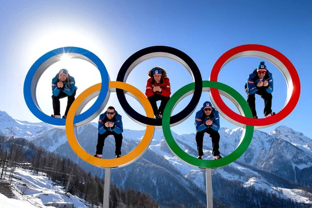 Austrian alpine skiers (LtoR) Georg Streitberger, Klaus Kroell, Max Franz, Joachim Puchner, Romed Baumann pose in the Olympic Rings on February 4, 2014 at the Mountain Olympic Village at the Rosa Khutor Alpine centre, four days prior to the start of the 2014 Sochi Winter Olympic Games. (Photo by Fabrice Coffrini/AFP Photo)