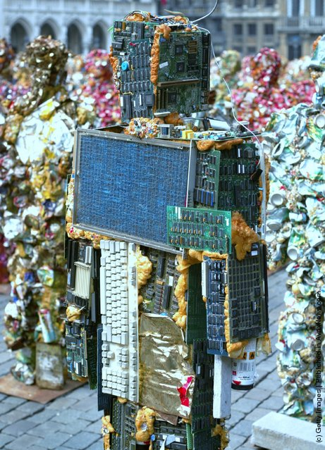 German artist Ha Schult unveils his latest exhibit Trash Peoples, a huge sculpture made of recycleble rubbish which will remain in place for 5 days at  Brussels' Grand Place, on April 1, 2005 in Brussels, Belgium