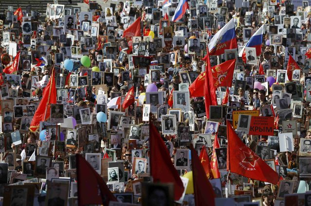 Participants of the Immortal Regiment march carry portraits of their relatives, who took part in World War Two in central Moscow, Russia, May 9, 2015. (Photo by Maxim Shemetov/Reuters)