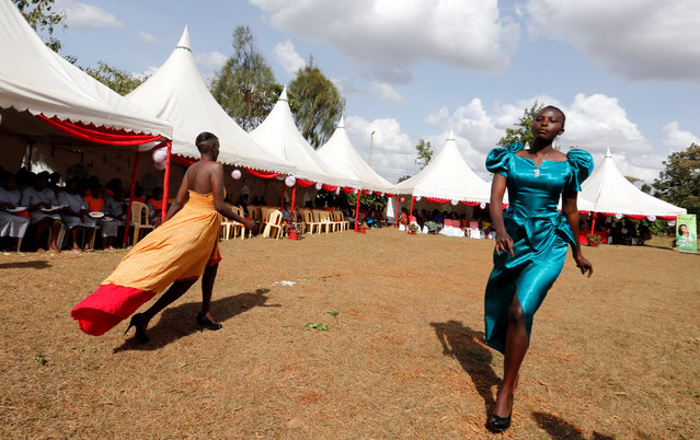 """Female inmates walk in a fashion parade as part of their Valentine's Day celebration, dubbed """"love behind bars"""" inside the Langata Women Maximum Security Prison in Kenya's capital Nairobi, February 14, 2017. (Photo by Thomas Mukoya/Reuters)"""