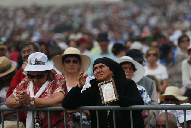 Worshippers attend a mass at the Our Lady of Fatima shrine, in Fatima, central Portugal, Wednesday, May 13, 2015. (Photo by Francisco Seco/AP Photo)