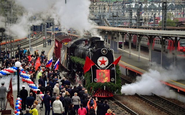The Pobeda (Victory) retro train arrives at a railway station in Vladivostok, Russia on May 8, 2019 on the eve of the 74th anniversary of the victory over Nazi Germany in the Great Patriotic War of 1941-1945, the Eastern Front of World War II. (Photo by Yuri Smityuk/TASS)