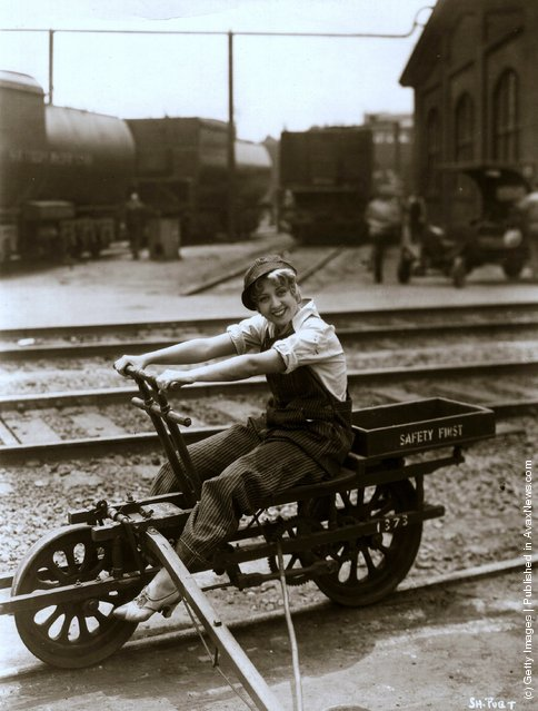 Joan Blondell the friendly comedienne is  riding on an American railway truck
