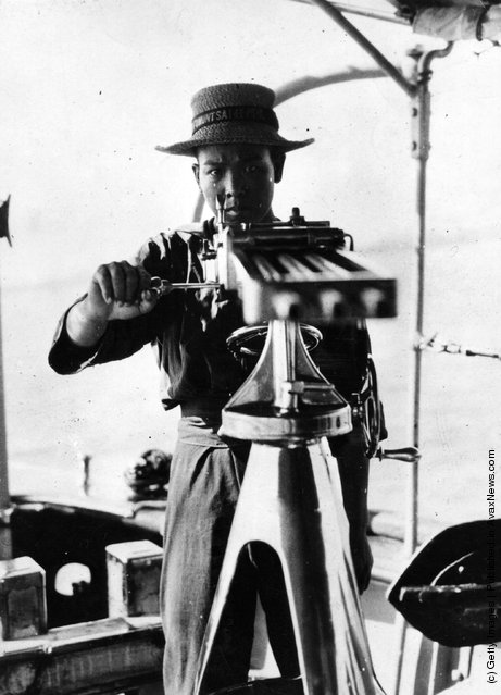 1925: A Chinese Marine looks down the barrels of a three barreled gun in Communist occupied Canton