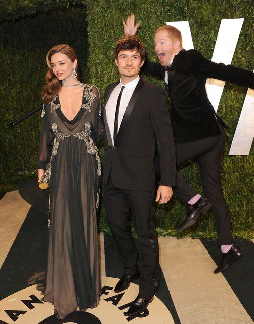Jesse Tyler Ferguson photobombs Miranda Kerr and Orlando Bloom at the 2013 Vanity Fair Oscar party. (Photo by Jon Kopaloff/FilmMagic)