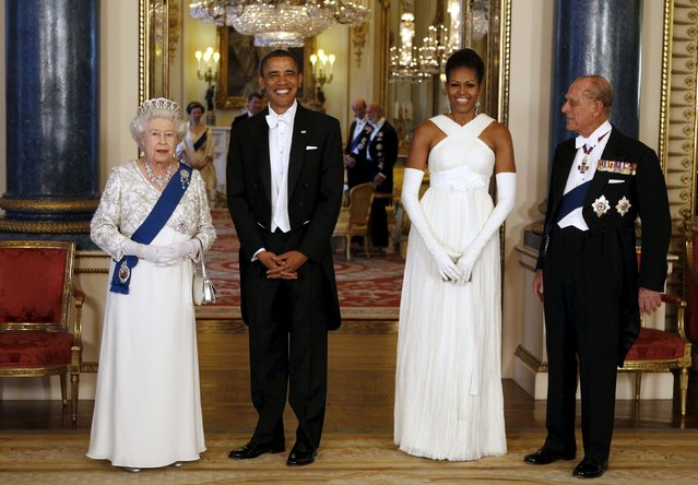 U.S. President Barack Obama (2nd L) and first lady Michelle Obama (2nd R) pose with Queen Elizabeth and Prince Phillip, Duke of Edinburgh before a State Dinner at Buckingham Palace in London in this May 24, 2011 file photo. (Photo by Larry Downing/Reuters)