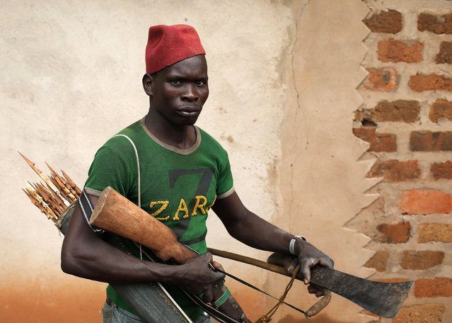 A member of the anti-balaka, a Christian militia, walks with his weapons in village of Zawa April 8, 2014. (Photo by Goran Tomasevic/Reuters)