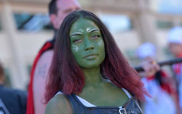A cosplayer made up as Gamora walks by the Convention Center during Comic Con in San Diego, California on July 18, 2019. (Photo by Chris Delmas/AFP Photo)