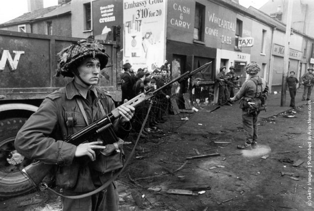 Newly arrived British soldiers stand on guard in the Catholic Fall's Road area of Belfast, 1969