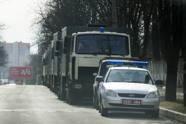 A line of police vehicles is seen through a car window prior to an opposition action in Minsk, Belarus, Saturday, March 25, 2017. The initial protests focused on the labor law but have grown to encompass calls for the resignation of President Alexander Lukashenko, whom critics call Europe's last dictator. (Photo by Sergei Grits/AP Photo)