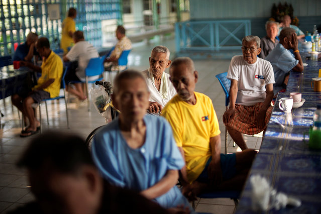 Elderly people gather before their breakfast at Bangkhae Home Foundation in Bangkok, Thailand, April 27, 2016. (Photo by Athit Perawongmetha/Reuters)