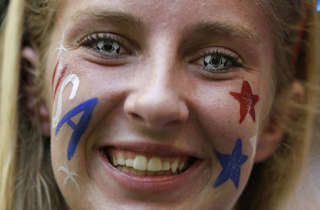 Krista McMahan, of St. Louis, wears soccer ball contact lenses as she cheers before the FIFA Women's World Cup soccer championship final between the United States and Japan in Vancouver, British Columbia, Canada, Sunday, July 5, 2015. (Photo by Elaine Thompson/AP Photo)