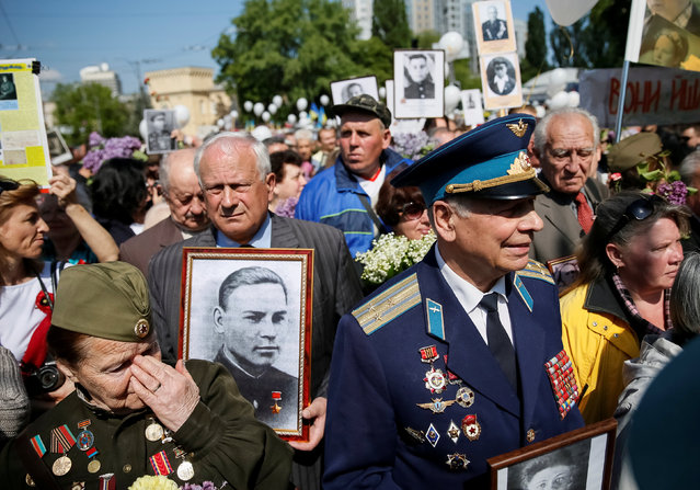 People carry pictures of World War Two participants as they take part in the Immortal Regiment march during the Victory Day celebrations, marking the 71st anniversary of the victory over Nazi Germany in World War Two, in central Kiev, Ukraine, May 9, 2016. (Photo by Gleb Garanich/Reuters)