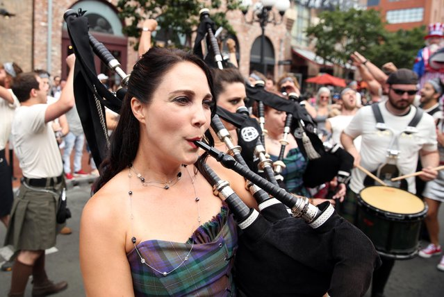 """Bagpipers dressed as Highlanders promoting the STARZ original series """"Outlander"""" are seen during San Diego Comic-Con on Friday, July 10, 2015 in San Diego. (Photo by Matt Sayles/Invision for STARZ/AP Images)"""
