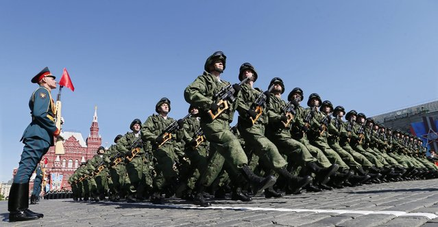 Russian military servicemen march during a military parade marking the 69th anniversary of the victory over the Nazi Germany in the WWII in the Red Square in Moscow, Russia 09 May 2014. (Photo by Yuri Kochetkov/EPA)