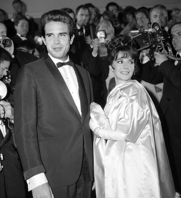 "American actors Warren Beatty and Natalie Wood pose for the photographers at the Cannes Festival in May n1962. Actor and film-maker, born in Richmond, Beatty made his film debut in ""Splendor in the Grass"" (1961). He produced ""Bonnie and Clyde"" (1967), co-wrote ""Shampoo"" (1975) and cop-directed ""Heaven can Wait"" (1978). (Photo by AFP Photo/Getty Images)"