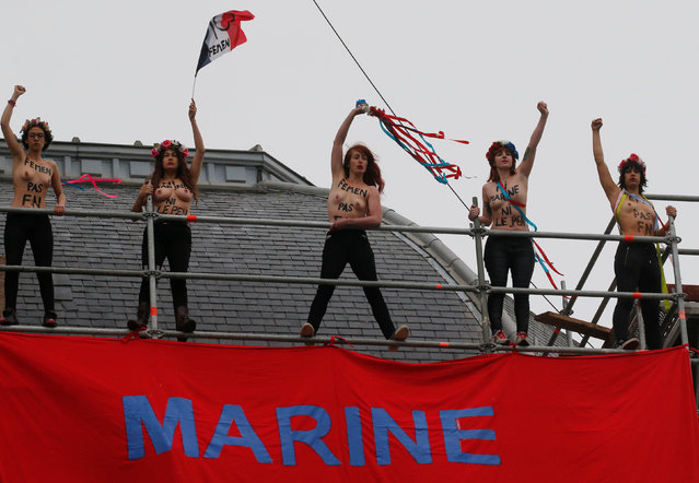 """Women's rights group FEMEN protest with a sign reading """"Marine in Power, Marianne in Despair"""" in the city of Hénin-Beaumont, during the second round of 2017 French presidential election, France, May 7, 2017. (Photo by Pascal Rossignol/Reuters)"""
