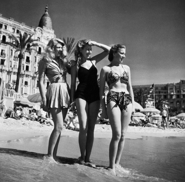 "A brilliantly captioned ""starlets on the beach"" photo, starring a trio of anonymous yet highly glamorous ladies. The 2nd Cannes International Film Festival, Cannes, France, 1947. (Photo by SIPA Press/Rex Features/Shutterstock)"