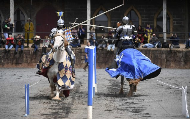 """Two jousting competitors come together during the inaugural """"Ashes"""" jousting tournament between Australia and England at the Kryal Castle in Leigh Creek, some 100 kms west of Melbourne, on November 3, 2019. (Photo by William West/AFP Photo)"""