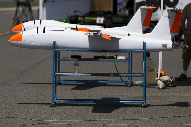"""A pair of Griffon Aerospace Outlaw G2 stand on the runway during """"Black Dart"""", a live-fly, live fire demonstration of 55 unmanned aerial vehicles, or drones, at Naval Base Ventura County Sea Range, Point Mugu, near Oxnard, California July 31, 2015. (Photo by Patrick T. Fallon/Reuters)"""