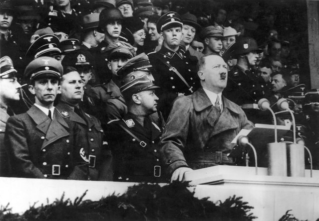 1st May 1936:  German dictator and head of the Nazi party, Adolf Hitler (1889 - 1945), delivering his May Day address at Lustgarten in Berlin. On the left is Joseph Goebbels (1897 - 1945)