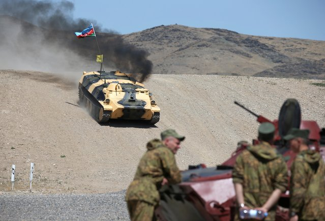An Azerbaijani armoured vehicle drives during the International Army Games at the 40th military base Otar in Zhambyl Region, Kazakhstan on August 7, 2019. (Photo by Pavel Mikheyev/Reuters)