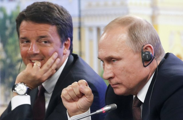 Russian President Vladimir Putin, right, and Italian Premier Matteo Renzi hold a joint news conference at the St. Petersburg International Economic Forum in St. Petersburg, Russia, Friday, June 17, 2016. (Photo by Dmitry Lovetsky/AP Photo)