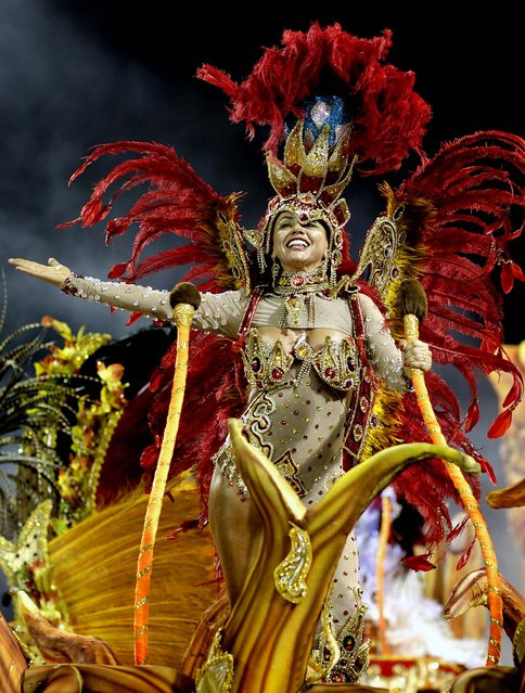A dancer from the Dragoes da Real samba school performs in Sao Paulo