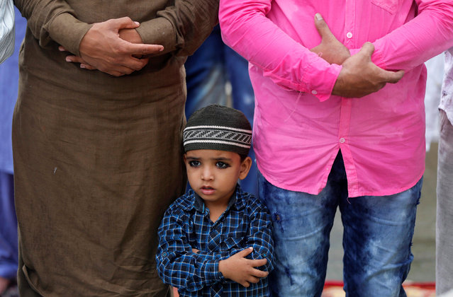 A Muslim boy takes part in Friday prayers on a street outside a mosque in Mumbai, India, June 24, 2016. (Photo by Shailesh Andrade/Reuters)