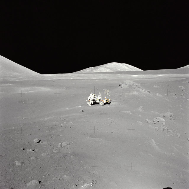 An extraordinary lunar panorama at Station 4 (Shorty Crater) showing Geologist-Astronaut Harrison H. Schmitt working at the Lunar Roving Vehicle (LRV) during the second Apollo 17 extravehicular activity (EVA-2) at the Taurus-Littrow landing site. This is the area where Schmitt first spotted the orange soil. Shorty Crater is to the right. The peak in the center background is Family Mountain. A portion of South Massif is on the horizon at the left edge. (Photo by NASA)