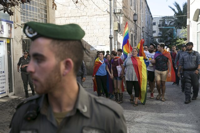 Israeli police and border police provide security as members of the gay community march against violence and for equal rights in Jerusalem August 14, 2015. (Photo by Baz Ratner/Reuters)