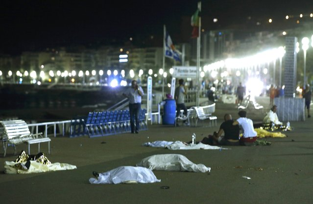 Bodies are seen on the ground July 15, 2016  after at least 30 people were killed in Nice, France, when a truck ran into a crowd celebrating the Bastille Day national holiday, July 14, 2016. (Photo by Eric Gaillard/Reuters)