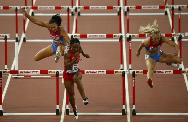 Andrea Ivancevic of Croatia trips on a hurdle (L) as Brianna Rollins of U.S. (C) leads in the women's 100 metres hurdles semi-final during the 15th IAAF World Championships at the National Stadium in Beijing, China August 28, 2015. (Photo by David Gray/Reuters)