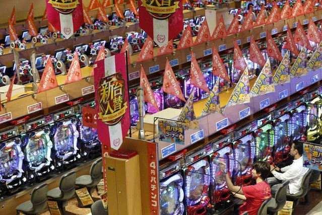 Visitors play Pachinko at a Dynam pachinko parlour in Honjo, north of Tokyo August 4, 2014. (Photo by Issei Kato/Reuters)