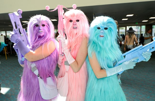 """Fans dressed as """"Chewie's Angels"""" pose for a photo on day two of Comic-Con International held at the San Diego Convention Center Friday, July 22, 2016, in San Diego. (Photo by Denis Poroy/Invision/AP Photo)"""