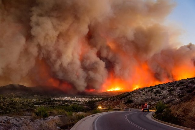 A picture made available on 26 July 2016 shows dense smoke over Lithi village  during a wildfire on Chios island, Greece, 25 July 2016. (Photo by Kostas Koyrgias/EPA)