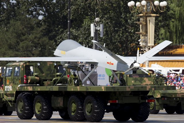 Military vehicles carrying Wing Loong, a Chinese-made medium altitude long endurance unmanned aerial vehicle, take part in a military parade to commemorate the 70th anniversary of the end of World War II in Beijing Thursday Sept. 3, 2015. (Photo by Andy Wong/Reuters)