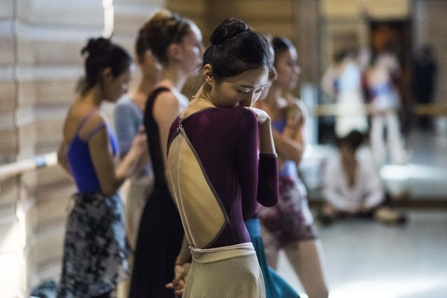 In this Tuesday, September 12, 2017 photo, South Korean dancer Eunsil Kim attends rehearse for Romeo and Juliet in Montevideo, Uruguay. Julio Bocca, director of Uruguay's National ballet of the Sodre, is attracting prestigious choreographers, instructors and international and local dancers to the company as he tries to old it into one of the best in the world. (Photo by Matilde Campodonico/AP Photo)
