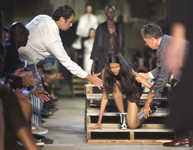 A model falls and gets help back to her feet during the fashion show for the Givenchy Spring 2016 collection at Fashion Week on, Friday, September 11, 2015, in New York. (Photo by Bebeto Matthews/AP Photo)