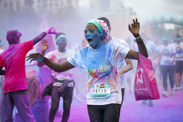 """Thousands take part in The Colour Run known as the """"happiest 5K on the planet"""", where runners hare doused in different colour explosions made from cornstarch at each kilometre mark of the 5km course around The O2, Greenwich, London. UK Sunday 4th September, 2016. (Photo by Amelia Rabin/SWNS.com)"""